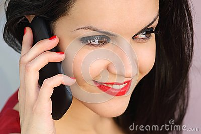 Close up of a beautiful woman on the phone