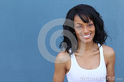 Close up beauty portrait of a young and attractive African American black woman with perfect skin, softly smiling Stock Photo