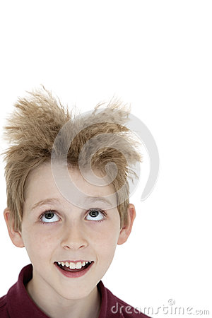 Close-up of blond boy looking up over white background