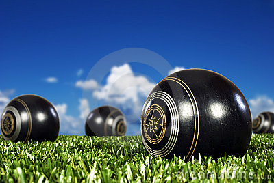 Close up of bowling balls on a bowling field