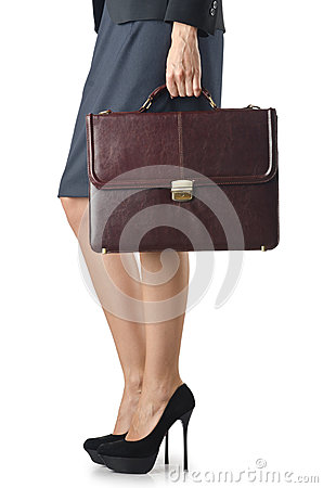 Close up of briefcase and businesswoman