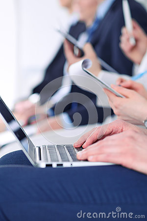 Close-up of business man hands typing on laptop computer at the conference Stock Photo