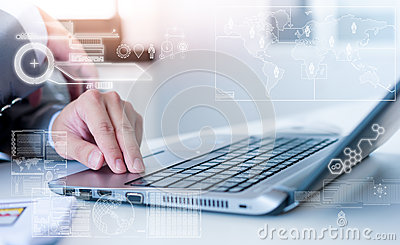 Close up of business man typing on laptop computer