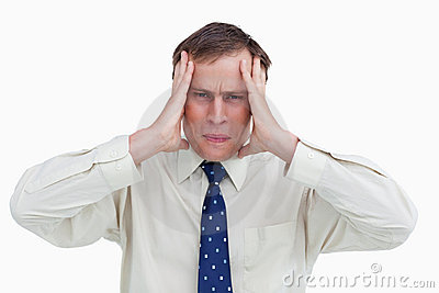 Close up of businessman experiencing a headache