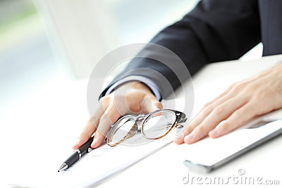 Close-up of businessman fill the form