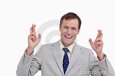 Close up of businessman with his fingers crossed
