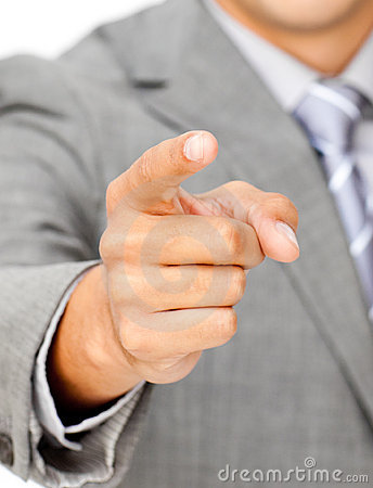 Close-up of a businessman pointing at the camera