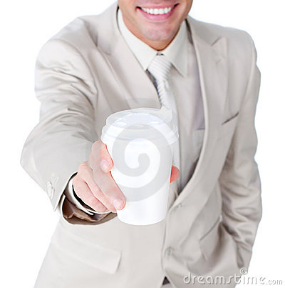 Close-up of a businessman showing a drinking cup