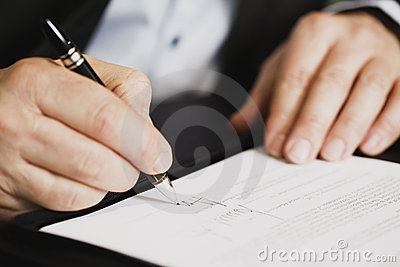 Close Up Of Businessman Signing A Contract. Royalty Free Stock Photography - Image: 18537867