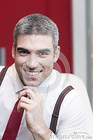 Close-up of businessman smiling at camera