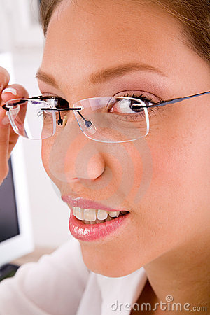 Close up of businesswoman holding eyewear