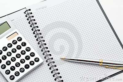 Close-up of calculator, pen and note on table