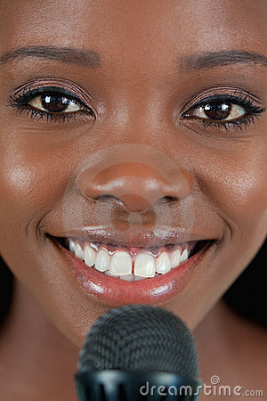 Close up of cheerful smiling female singer