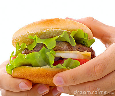 A close up cheeseburger being held in hands