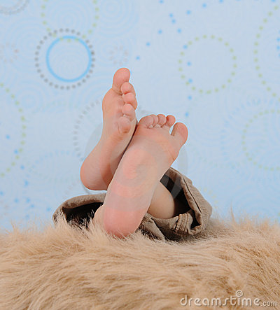 Close-up of a child s feet over  furry blanket