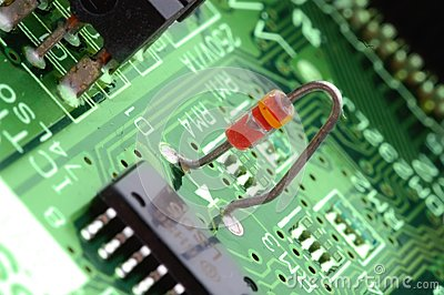 Close-up chip on green motherboard