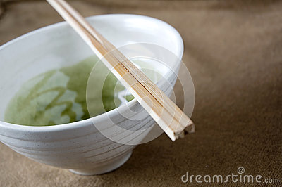 Close up chopstick on bowl