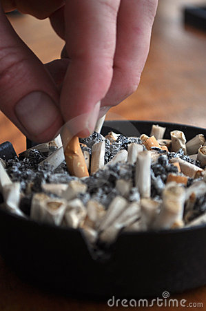 Close up of Cigarette Being Stubbed Out in Ashtray