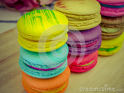 Close up of colorful macarons on wooden background Stock Photo