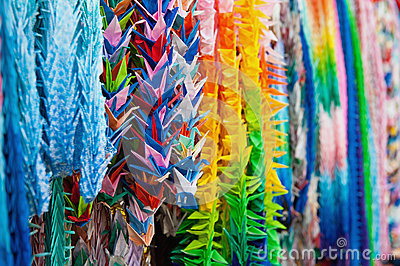 Close up of colorful origami offerings