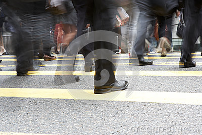Close Up Of Commuters Feet Crossing Busy Street