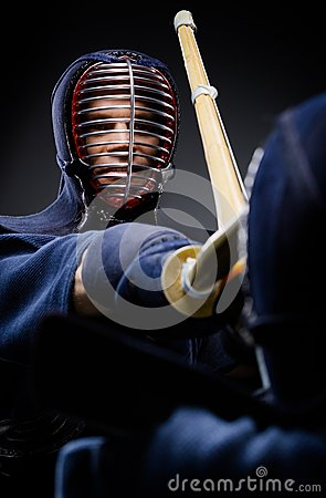 Close up of competition of two kendo fighters