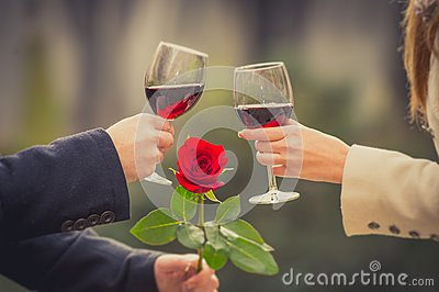Close Up Of A Couple Drinking Wine On Valentines Day Stock