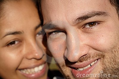 Close-up of a couple smiling in sunlight