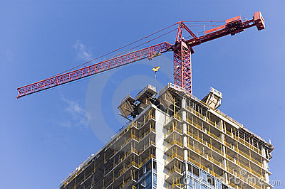 Close up of crane on top of high rise building