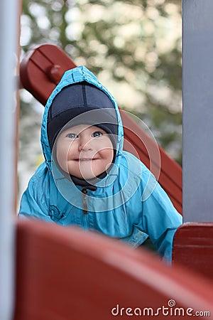 Close-up of cute beautiful small boy outside
