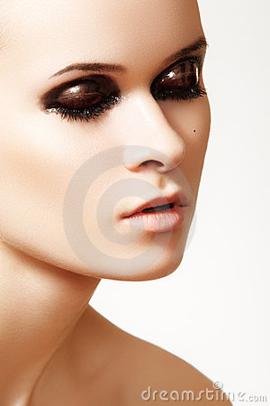 Close-up of cute model with fashion gloss make-up