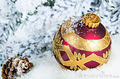 Close up of decorative Christmas ball on the snow