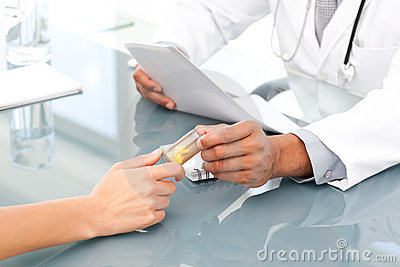 Close up of a doctor giving drugs to his patient