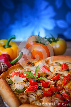 Close up on dressing of sea food pizza vertical form