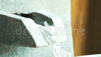 Close-up of exterior tap water dripping  Modern beautiful stone bath tap  leaks