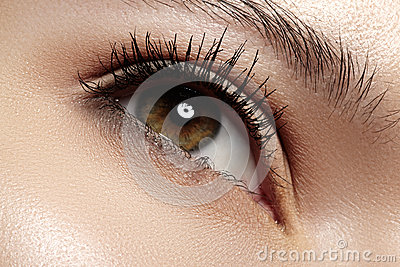 Close-up eye with fashion light make-up, long eyelashes