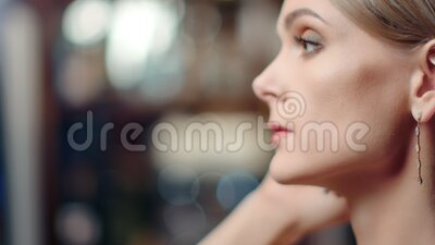 Close up face of adorable woman with evening makeup wearing gold earrings. 4k Dragon RED camera. Close up face of adorable woman with evening makeup wearing gold stock video footage