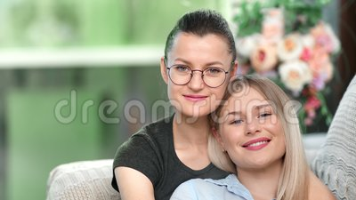 Two Happy Young Smiling Same Sex Mother Reading Book With Their