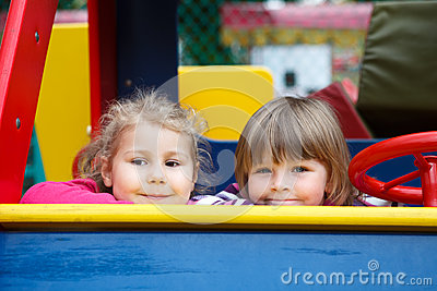 Close up of faces of two happy playful girls