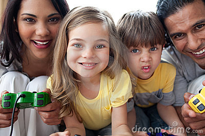 Close-up of family playing video game