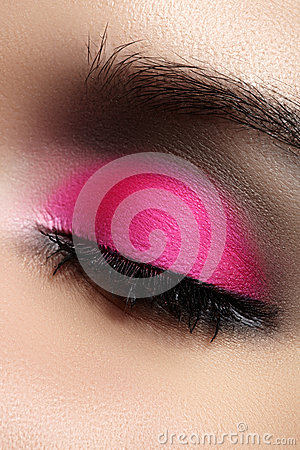 Close-up of fashion eyes make-up, bright pink eyeshadow