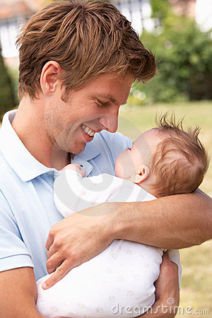 Close Up Of Father Cuddling Newborn Baby Boy Outdo