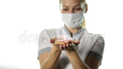 Close-up of female doctor hands holding pink ribbon. breast cancer awareness. healthcare and medicine concept.  stock footage