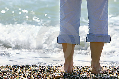 Close up of female feet on beach