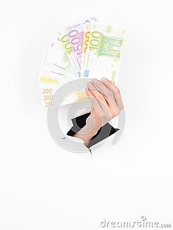 Female hand holding euros