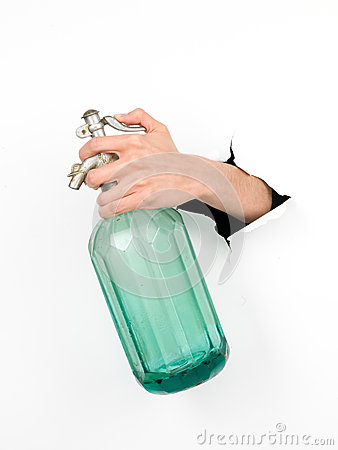 Hand holding a vintage soda bottle