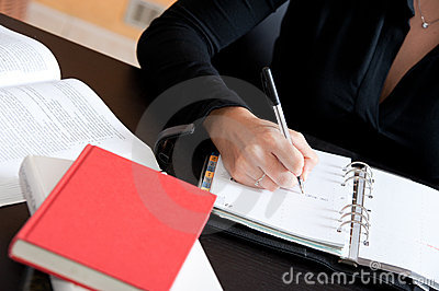 Close up Female hand writing notes