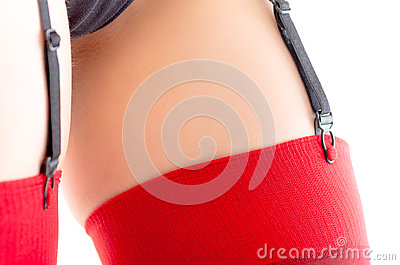 Close-up of female stockings suspenders on white