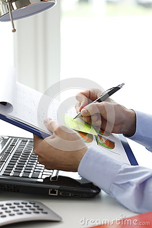 Close-up of financial advisor fill the document