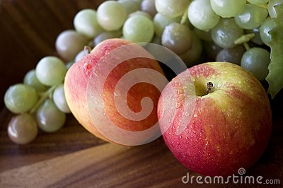 Close up fresh apples and grapes
